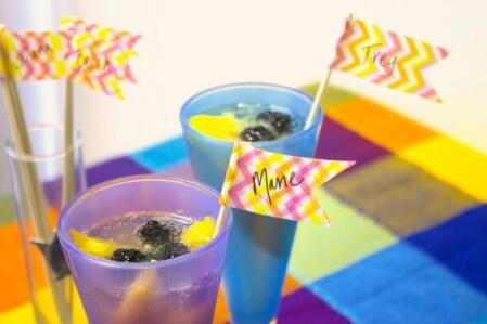 Summer Drinks in Colored Glasses