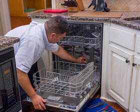 Dishwasher being repaired by Mr. Appliance