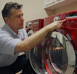 Washer and dryer being repair by Mr. Appliance technician